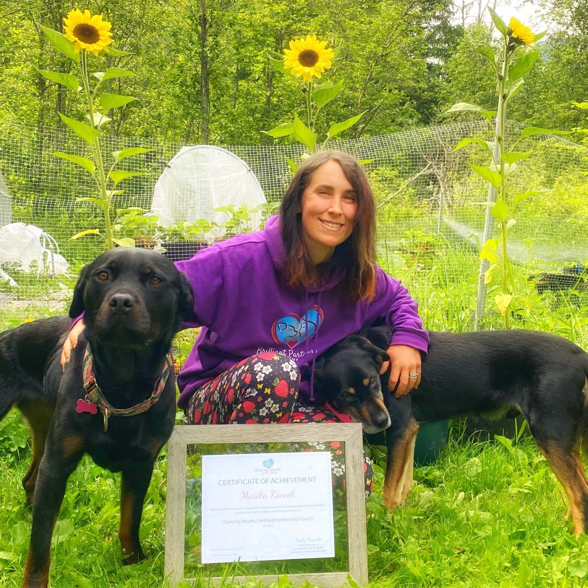 Coach Marika with her dogs in the garden
